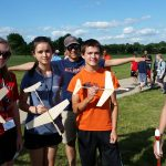 Students at launch site with gliders
