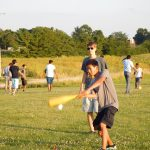 Students playing wiffle ball