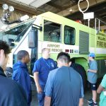 Students at Willard airport learning about emergency response team