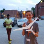High school student with model glider