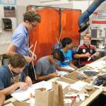 High school students building models during workshop