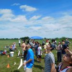 Students and staff watching glider aloft