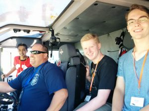 Students riding in CMI fire truck