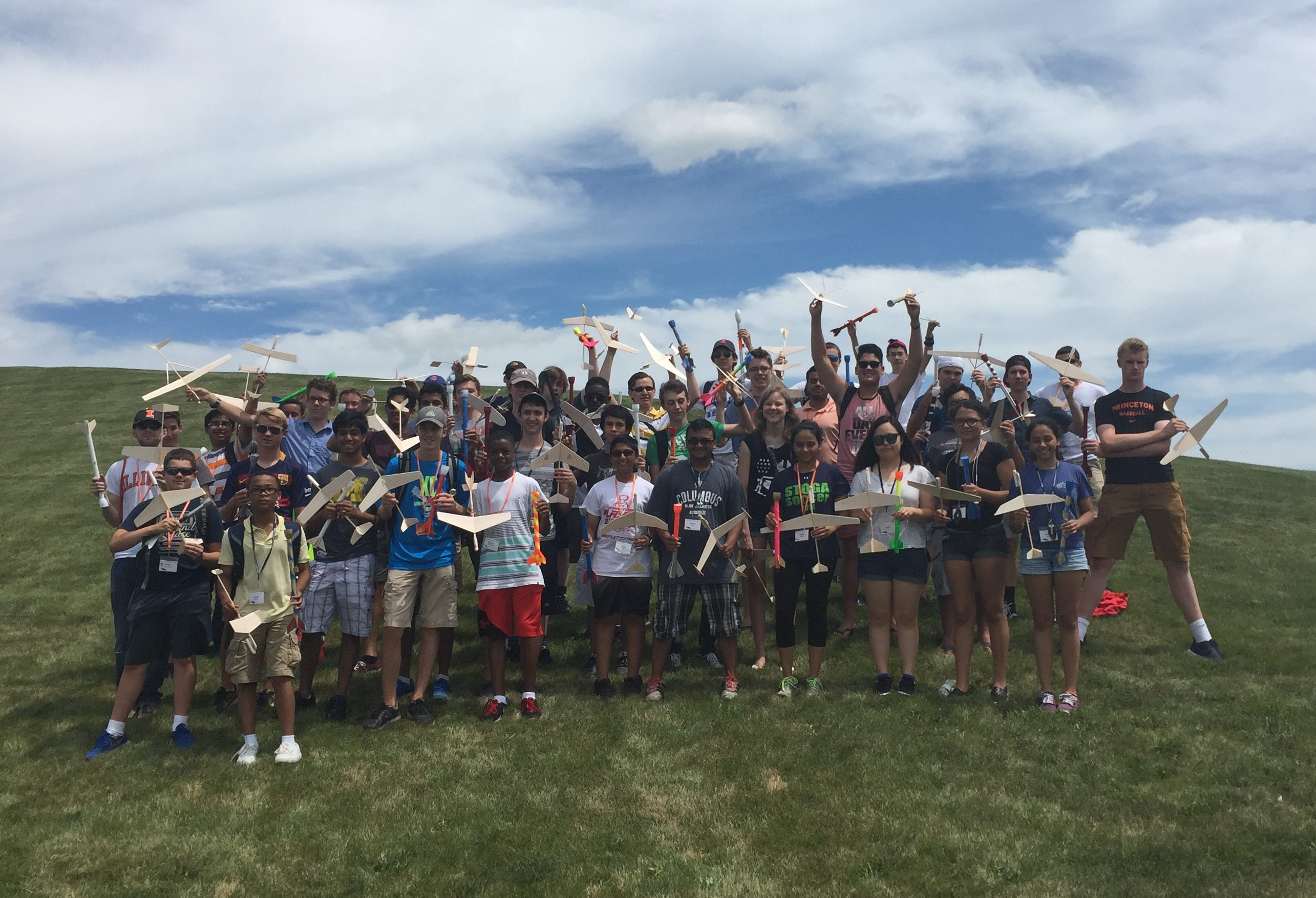 Students with model rockets and gliders