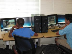 Students learning at computer stations