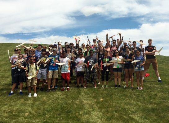 Students with model rockets and boost gliders